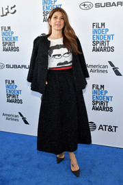 Marisa Tomei teamed a black tweed skirt suit by Co with a cute graphic tee for the 2019 Film Independent Spirit Awards.