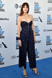Dakota Johnson matched her top with a pair of print pants.