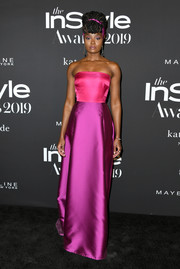 Kiki Layne brought a pop of color to the black carpet with this strapless two-tone gown by Kate Spade at the 2019 InStyle Awards.