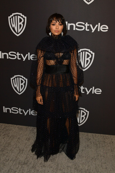 Kat Graham turned heads in a sheer dotted gown by Genny at the InStyle and Warner Bros. Golden Globes after-party.
