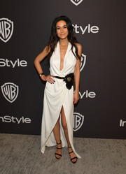 Emmanuelle Chriqui looked alluring in a plunging white wrap dress by Haney at the InStyle and Warner Bros. Golden Globes after-party.