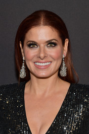 Debra Messing attended the InStyle and Warner Bros. Golden Globes after-party wearing her hair in a straight center-parted 'do.