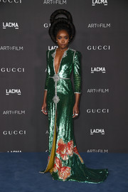 Kiki Layne made a shimmering entrance at the 2019 LACMA Art + Film Gala in a green sequined gown with a plunging neckline and floral detailing.