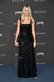 Sienna Miller glittered in a black paillette gown by Gucci at the 2019 LACMA Art + Film Gala.