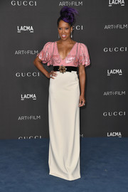 Regina King went for whimsical glamour in a pink, white, and black empire gown with a trompe l'oeil bodice at the 2019 LACMA Art + Film Gala.