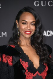 Zoe Saldana's red lipstick totally popped against her dark outfit.