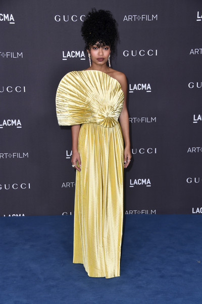 Yara Shahidi was a glamorous drop of sunshine in a pleated yellow one-shoulder gown with a fan-like bodice at the 2019 LACMA Art + Film Gala.