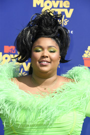 Lizzo went majorly funky with this messy, voluminous updo at the 2019 MTV Movie & TV Awards.