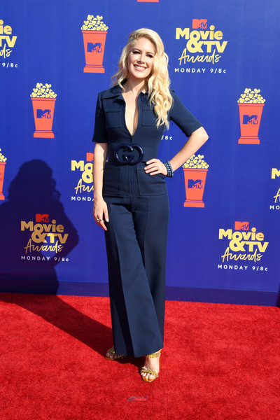 Heidi Montag went the retro route in a navy bell-bottom jumpsuit by Gucci at the 2019 MTV Movie and TV Awards.