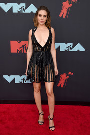 Alison Brie got majorly vampy in sheer, plunging LBD by Elie Saab at the 2019 MTV VMAs.