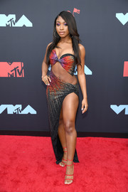 Normani finished off her head-turning look with strappy red heels.
