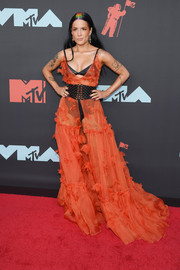 Halsey was boho-sexy in a sheer burnt-orange gown by Dundas Couture, which she layered over black undies, at the 2019 MTV VMAs.