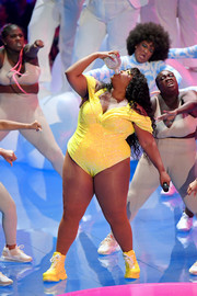 Lizzo matched her bodysuit with a pair of yellow boots.