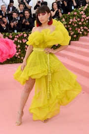 Charli XCX was a drop of sunshine in an asymmetrical yellow ruffle dress by Jean Paul Gaultier at the 2019 Met Gala.