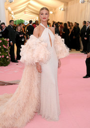 Rosie Huntington-Whiteley ravished in a white keyhole halter gown by Oscar de la Renta at the 2019 Met Gala.