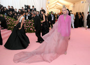 Pom Klementieff made a head-turning entrance in a hot-pink Ferragamo tuxedo dress with a flowing blush overlay at the 2019 Met Gala.