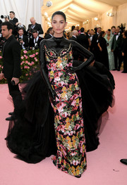 Lily Aldridge looked like a work of art in this Richard Quinn design, which featured colorful floral beading, a latex neckline and sleeves, and a voluminous tulle train, at the 2019 Met Gala.
