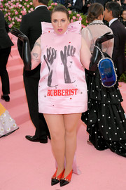 Lena Dunham looked quirky in a glove-print mini dress by Christopher Kane at the 2019 Met Gala.