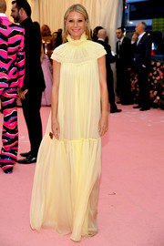 Gwyneth Paltrow kept it simple yet charming in a yellow maxi dress by Chloé at the 2019 Met Gala.