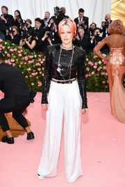 Kristen Stewart teamed her top with white wide-leg pants, also by Chanel.