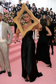 Tracee Ellis Ross turned heads in a ruched black Moschino gown with a picture frame adornment at the 2019 Met Gala.