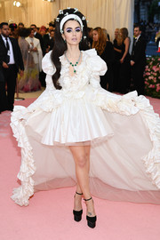 Lily Collins gave us '60s-bride vibes in a ruffled white Giambattista Valli Couture dress with a super-long train at the 2019 Met Gala.