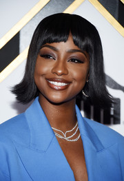 Justine Skye looked quirky wearing this short 'do with flipped ends and baby bangs at the 2019 Roc Nation brunch.
