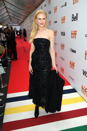 Nicole Kidman opted for a pair of black ankle boots to finish off her look.