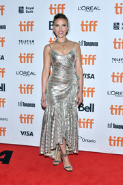 Scarlett Johansson went for festive glamour in a silver ruffle-hem dress by Rodarte at the TIFF premiere of 'Jojo Rabbit.'