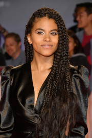 Zazie Beetz perked up her eyes with silver glitter shadow.