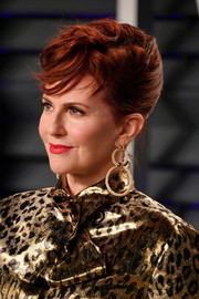 Megan Mullally looked so cool with her rockabilly updo at the 2019 Vanity Fair Oscar party.