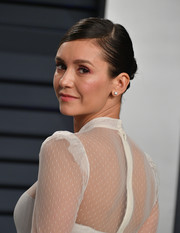 Nina Dobrev went for a classic side-parted bun at the 2019 Vanity Fair Oscar party.