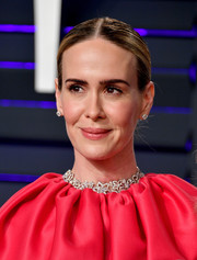 Sarah Paulson styled her hair into a center-parted braided bun for the 2019 Vanity Fair Oscar party.