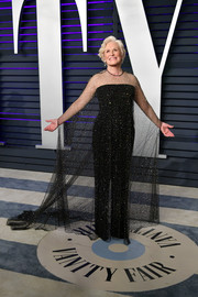 Glenn Close looked tres chic in a black Armani Prive jumpsuit with a sheer, embellished overlay at the 2019 Vanity Fair Oscar party.