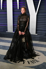 Sasha Lane was a goth princess in a sheer black ballgown by Valentino at the 2019 Vanity Fair Oscar party.