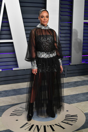 Tessa Thompson donned a sheer black Chanel Couture gown with a sequined underlay for the 2019 Vanity Fair Oscar party.