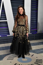 Michelle Yeoh chose a black Elie Saab Couture gown with gold embroidery for the 2019 Vanity Fair Oscar party.