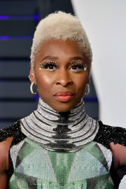 Cynthia Erivo turned heads with her white curls and studded eye makeup at the 2019 Vanity Fair Oscar party.