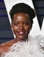 Lupita Nyong'o looked funky with her curly pompadour at the 2019 Vanity Fair Oscar party.
