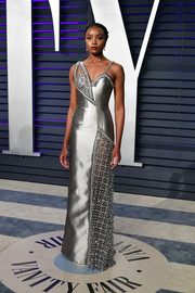 Kiki Layne was a standout in an asymmetrical silver gown by Atelier Versace at the 2019 Vanity Fair Oscar party.
