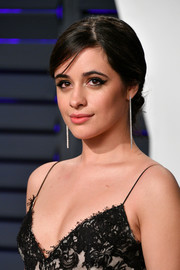 Camila Cabello wore her hair in an elegant chignon at the 2019 Vanity Fair Oscar party.