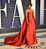 Gabrielle Union dropped jaws in a strapless red Valentino Couture gown with a long train at the 2019 Vanity Fair Oscar party.