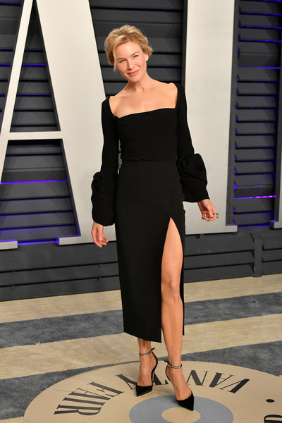 Renee Zellweger looked sultry in a high-slit LBD by A.W.A.K.E. at the 2019 Vanity Fair Oscar party.