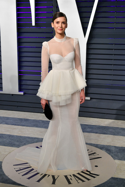 Nina Dobrev donned a dramatic white corset gown by Brock Collection for the 2019 Vanity Fair Oscar party.