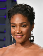Tiffany Haddish styled her hair into a pompadour for the 2019 Vanity Fair Oscar party.