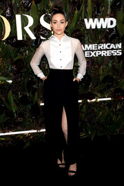 Emmy Rossum finished off her outfit with a high-slit black maxi skirt, also by Armani.