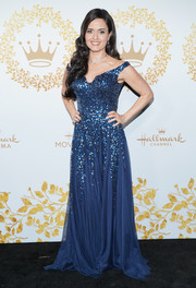 Danica McKellar sparkled in a blue Shail K. off-the-shoulder gown embellished with a waterfall of sequins at the 2019 Winter TCA Tour.