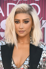Shay Mitchell debuted a platinum-blonde shag at the 2019 iHeartRadio Music Awards.