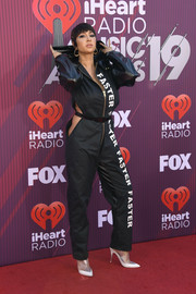 Jackie Cruz looked provocative in a black cutout jumpsuit by Viktor Luna at the 2019 iHeartRadio Music Awards.