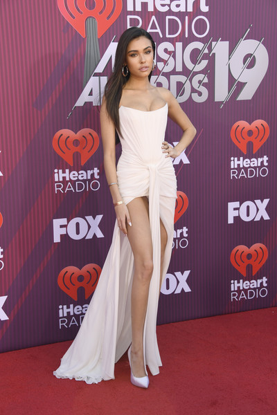 Madison Beer looked sultry in a strapless cream corset gown with a high front slit at the 2019 iHeartRadio Music Awards.